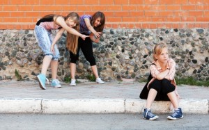 Teenage girls in conflict at the school building